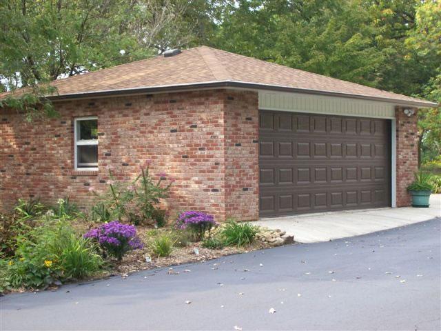 Muret garage g r det selv eller modtag 3 gratis tilbud for Garage pons muret